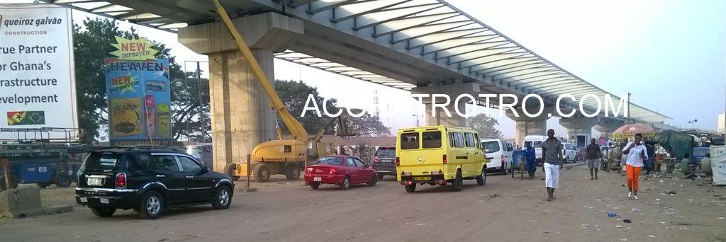 A yellow Accra trotro bus passes the new Circle interchange.