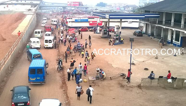 Accra Circle trotro station road in front of Fraga filling station. The photo was taken from the old overhead bridge during a harmatan - foggy - morning.