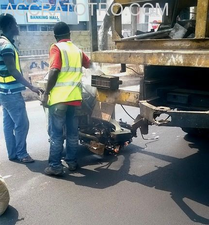 Constriction crew with road marking equipment on the Accra Circle Labone trotro route